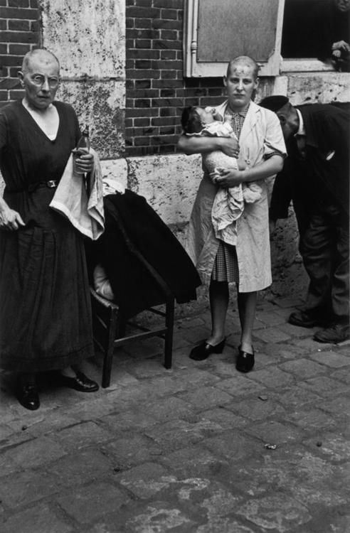 A French woman who conceived a baby with a German soldier, punished by having to have her head shaved as a form of humiliation for her acts.  Her mother also was subjected to the punishment - June 1944: