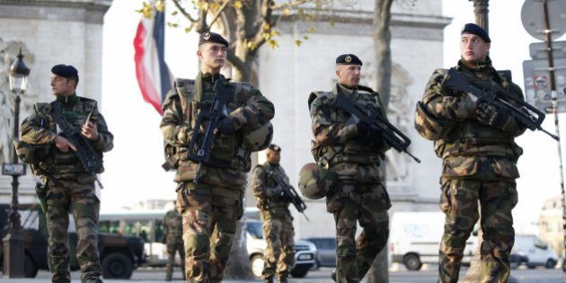 French soldiers patrol in front of the Arc de Triomphe on the Champs Elysees avenue in Paris, France