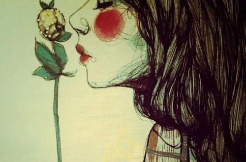 femme-sentant-une-fleur-500x330