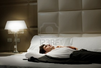 9260271-tired-businessman-resting-in-hotel-room