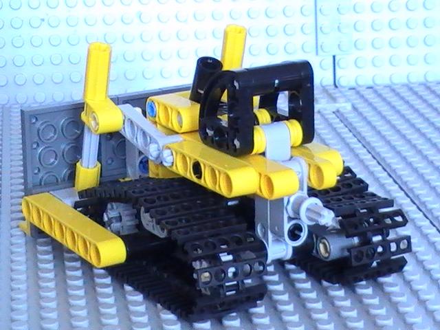 Légo technic n° 8259 de 2009 - Boite deux en un bull et pelleteuse.