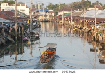stock-photo-view-on-amphawa-floating-market-early-in-the-morning-with-boat-sailing-thailand-79478026