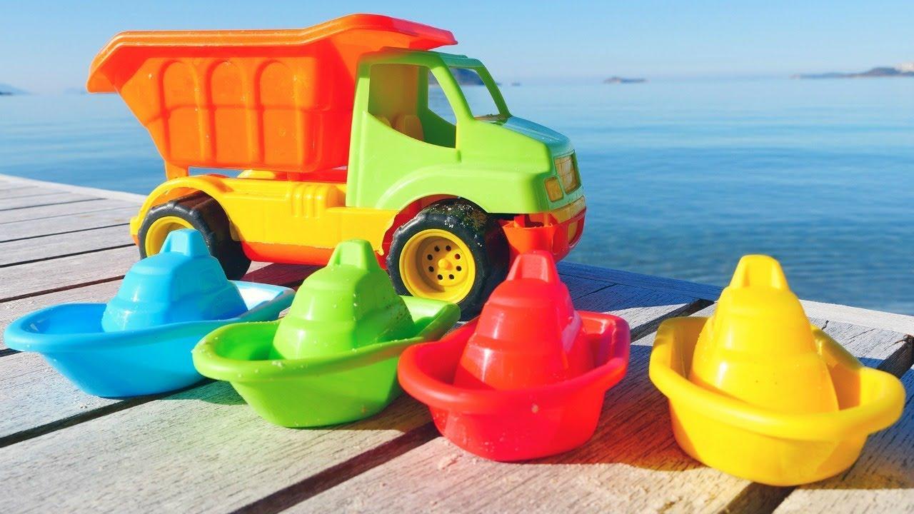 Jeux de sable sur la plage pour enfants. Couleurs en français - YouTube