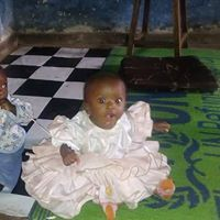L'image contient peut-être: 1 personne, assis et bébé