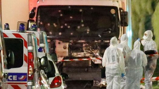 french-police-forces-and-forensic-officers-stand-next-to-a-truck-that-ran-into-a-crowd-celebrating-the-bastille-day-national-holiday-on-the-promenade-des-anglais-killing-at-least-60-people-in-nice-1_5638141