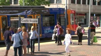 stock-footage-sheffield-uk-july-people-on-a-platform-as-a-street-tram-leaves-a-stop