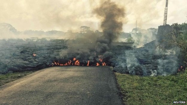 The lava flow from the Kilauea Volcano is seen crossing Apa'a Street/Cemetery Road in this U.S. Geological Survey (USGS) image taken near the village of Pahoa <a style=