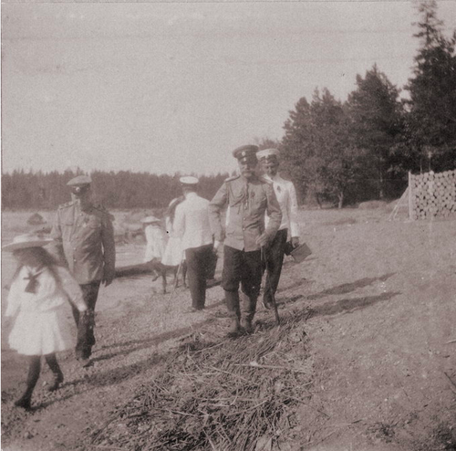 Grand Duchess Anastasia, Nicholas II, and two of the elder grand duchesses in the background: Finland, 1908.