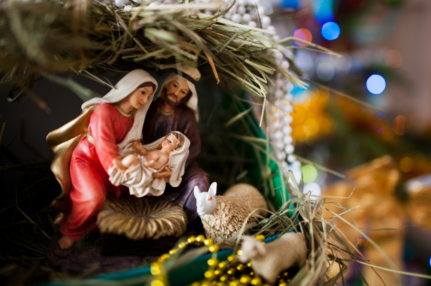Virgin mary gave birth to jesus, and it lies in the crib, christmas Premium Photo