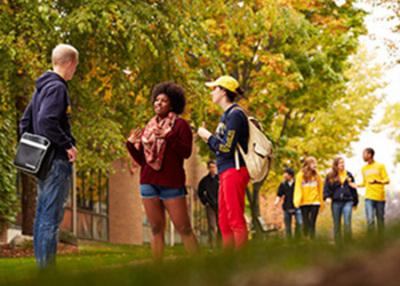 books autumn students walking campus