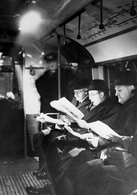 New lights installed in London Subways. London, England, 1940. Travelers reading by the light of new lamps installed in the London subways. The lights have been approved by the various defense bureaus and will provide full peace-time light while the trains are in tunnels. During air raid alarms they will be turned out and subdued lights used. (Photo by Bettmann/Getty Images)