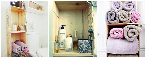 Petit meuble avec des caisses à vin dans la salle de bains