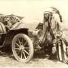 A Native American man cranking an early automobile. ca. 1915