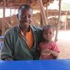 Burkina Tenkodogo Le peintre avec une petite fille