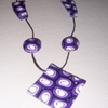 collier spirale violet VENDU