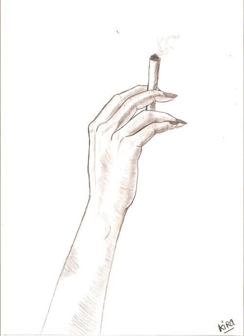 Une main et une cigarette .