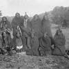 Comanche group, including Chief Quanah Parker (sitting second from left). Possibly during peyote cer