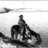 From a dry state. A Navajo man on a horse by river or lake. 1915. Photo by William J. Carpenter