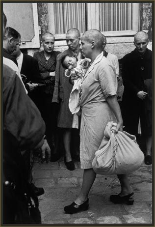 Robert Capa - Chartres, France, August 18th, 1944: Just after the liberation of the town, this French woman who had had a baby with a German soldier has her head shaved as punishment.  During the middle ages, this mark of shame, denuding a woman of what was supposed to be her most seductive feature, was commonly a punishment for adultery. Shaving women's heads as a mark of retribution and humiliation was reintroduced in the 20th century and was widespread post WW2.: