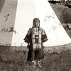 Crow girl in front of tipi. Early 1900s. Photo by Richard Throssel. Source - University of Wyoming.