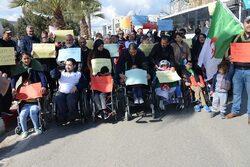 les personnes à mobilité réduite ont marché à Béjaia