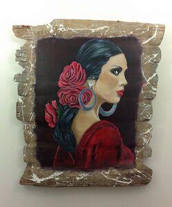 Flamenco sur tableau en bois flotté