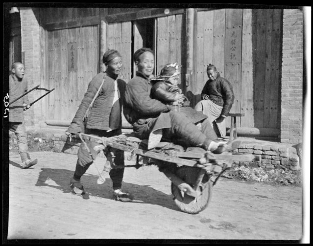 Man on Wheelbarrow. China, Kaifeng Xian, 1917-1919. (Photo by Sidney David Gamble)