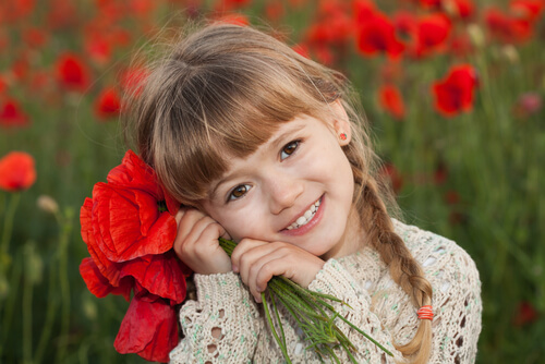Le sourire et une clé secrète qui ouvre bien des coeurs.