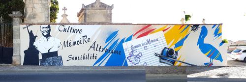 Realisation d'une oeuvre originale 83m x 4m sur le mur d'entrée de la commune de Puisserguier (34) Juillet 2017. http://www.jerc-tbm.com/crbst_7.html