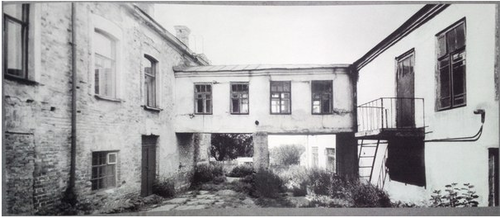 The courtyard at the Ipatiev House that the Imperial family passed through to the cellar. The gallery was added in the 1930s.