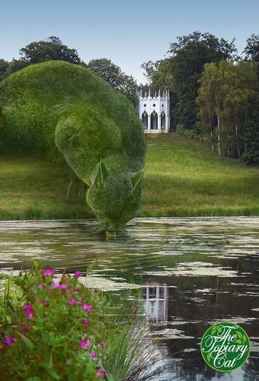 Topiary cat drinking at lake