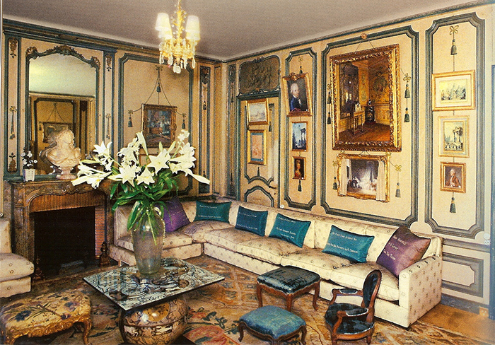"De Wolfe's private sitting room at Villa Trianon. The pillows are embroidered with her aphorisms: ""Never explain, never complain"" and ""I believe in optimism and plenty of white paint!"""