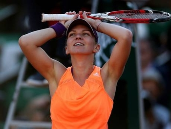 Simona-Halep-of-Romania-celebrates-victory-during-her-women's-singles-match-against-Andrea-Petkovic-of-Germany-on-day-twelve-of-the-French-Open