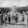 Taos runners and spectators attend a Feast Day foot race at Taos Pueblo in New Mexico - 1884
