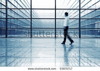 stock-photo-image-of-people-silhouettes-at-morden-office-building-55870717