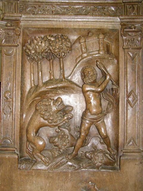 Fig.1- Stalles de la collégiale de Montréal (Yonne): Homme à demi-nu se battant contre un lion.
