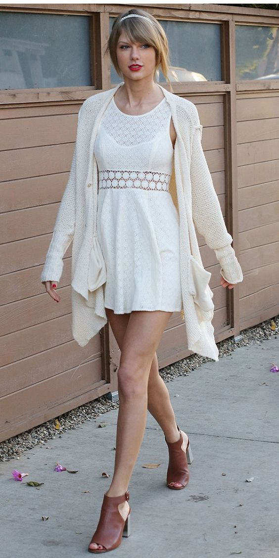 Taylor Swift soaks up the L.A. sun in  this cute white cardigan and cutout dress.: