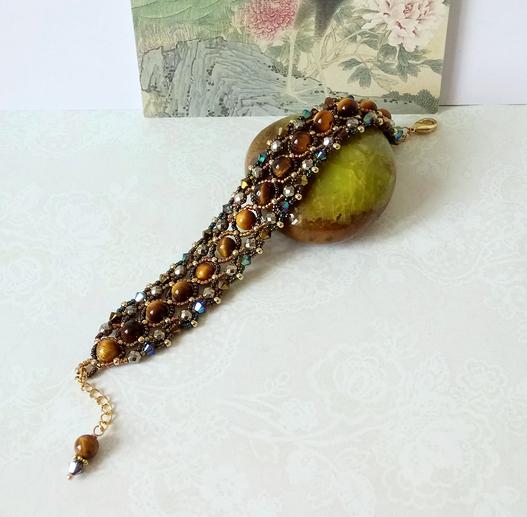 Bracelet tissé Pierre oeil du tigre, pyrite et Cristal de Swarovski / laiton doré