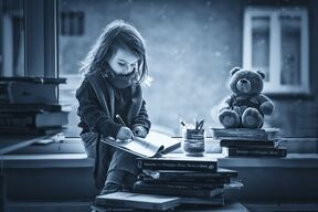 Photograph Adorable little girl, writing letter to Santa, sitting ...
